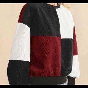 Cute colorblock Corduroy sweater.